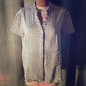 Short sleeved, button down blouse.